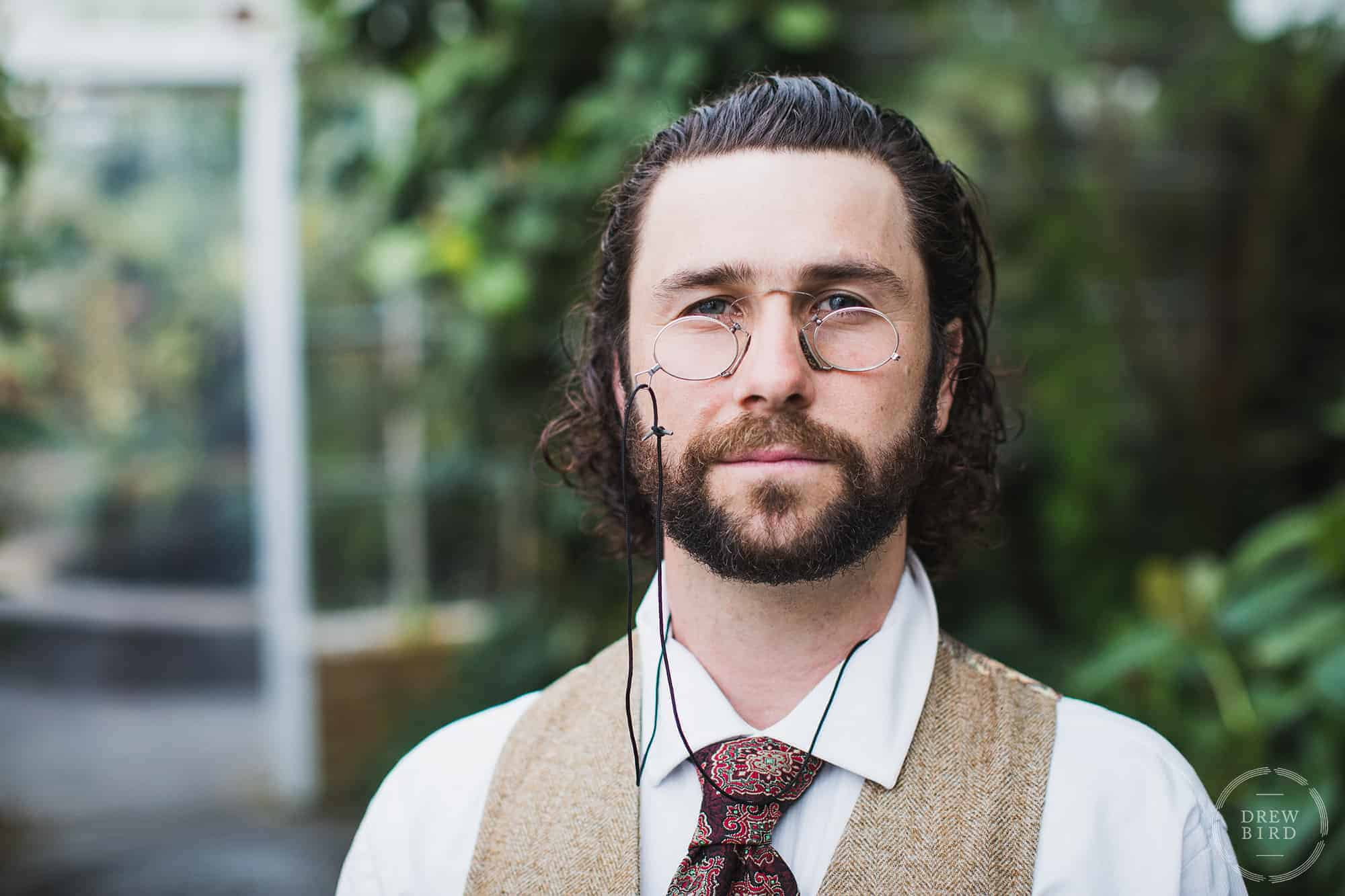 Man with spectacles and a beard at the conservatory of flowers. San Francisco editorial portrait and headshot photographer Drew Bird.