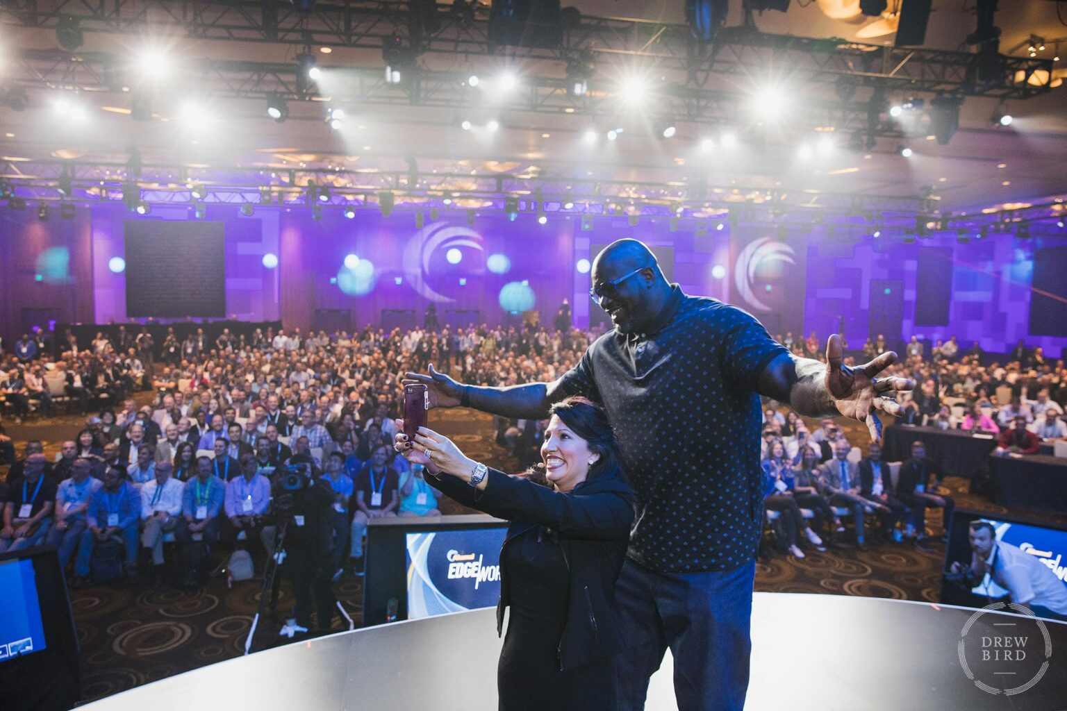 NBA star Shaquille O'Neal posing for selfie onstage in Las Vegas at the Aria Hotel. San Francisco corporate lifestyle photographer Drew Bird.