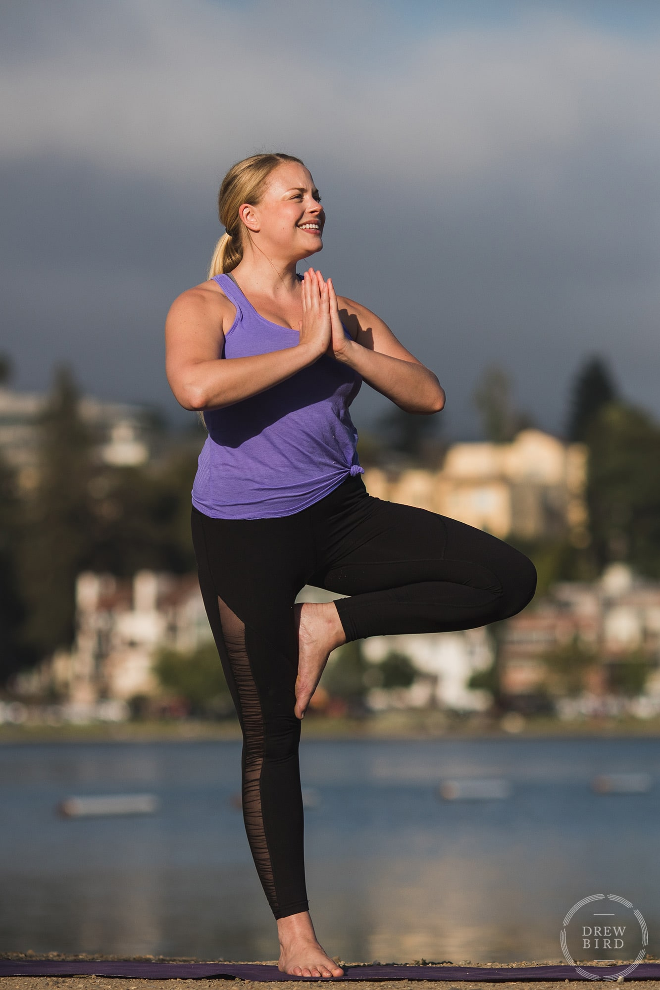 Yoga instructor in tree pose on shores of Lake Merrit in Oakland. San Francisco yoga instructor, brand, and commercial photographer Drew Bird.